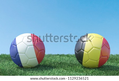 two soccer balls in flags...