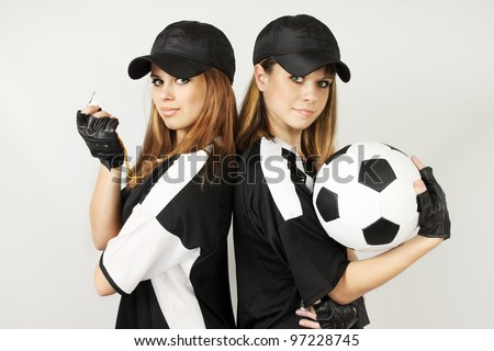 Two soccer coaches with the ball and the whistle - stock photo