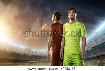 Two soccer players on a stadium #602581934