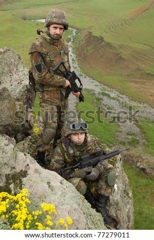 Two soldiers in heavy combative ammunition