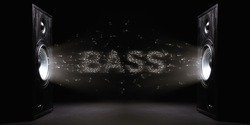 Two sound speakers with text bass between them on black  background. Black and white image.