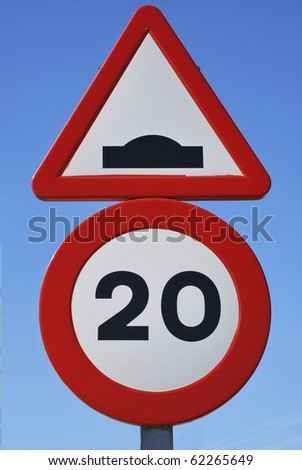 Two spanish traffic signs. Limit of velocity and speed bump