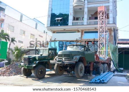 Two specialized machines drill water wells 2, Cambodia