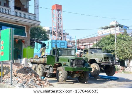 Two specialized machines drill water wells 1, Cambodia