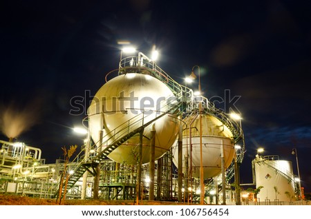 Two sphere gas storages in petrochemical plant  at night