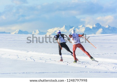 two sportsmen doing wintry skating exercise in snowy nature
