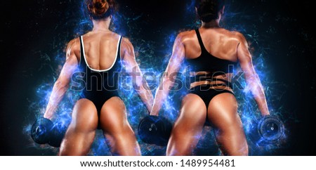 Two sporty and fit women athletes, bodybuilders. Workout and fitness motivation. Black background. Energy bodybuilding concept. Sexy ass in thong.