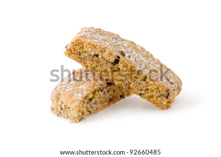 Two stacked pieces of jewish twice-baked almond cookies similar to biscotti against a white background.