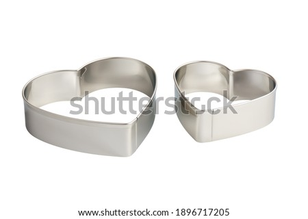 Two stainless steel heart-shaped cookie cutters, isolated Photo stock ©