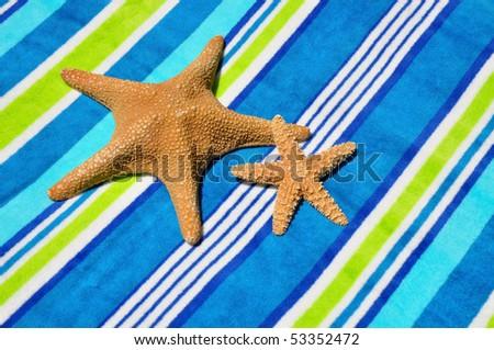 Two star fish on beach towel