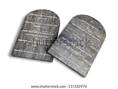 Two stone tablets with the ten commandments inscribed on them on an isolated background - stock photo