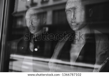 Two store mannequins. fashion mannequin, Mannequin faces, black and white art photo, Portrait of female mannequins in store window, buildings, toned image, window doll dummy