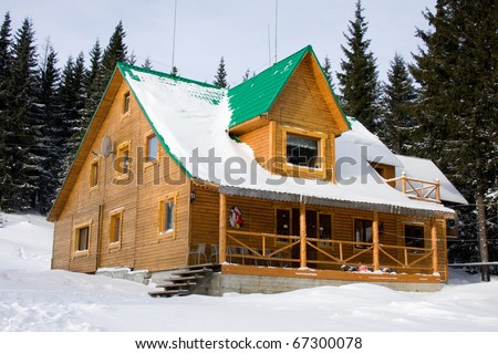 Two-storeyed wooden house concealed by snow, Ukraine, Carpathian mountains, Dragobrat