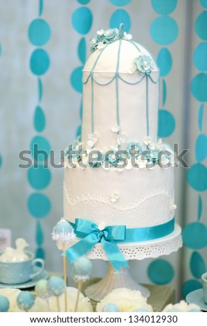 Two stories wedding cake decorated with blue flowers