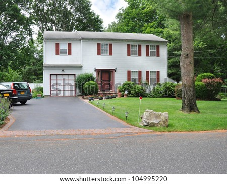 Two story high ranch house blacktop driveway suburban for High ranch house