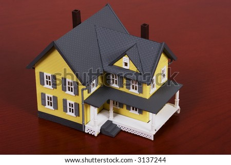 Two-story house with red wooden background background