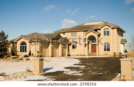 Two-story upper class brick luxury home with triple garage.