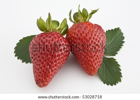 Two strawberries with leaf isolated