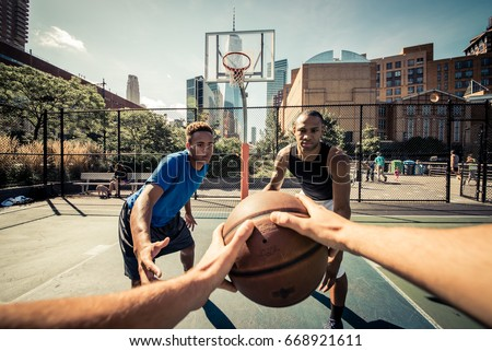 Shutterstock Two street basketball players playing hard on the court