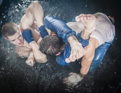 Two strong man fighting in water