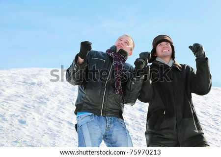 Two students look in sky and squeeze fists