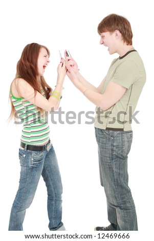 Two students with cellphones over white