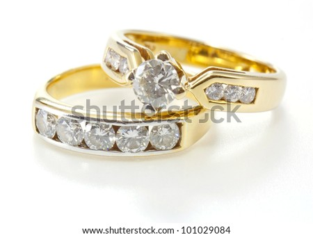 Two styles of golden ring with diamond isolated on white background.