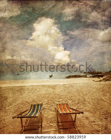 two sun beach chairs on shore...