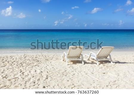 Two sunbeds at Caribbean Sea beach
