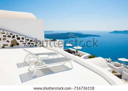 Two sunbeds on the terrace with sea view. Santorini island, Greece.  #716736118