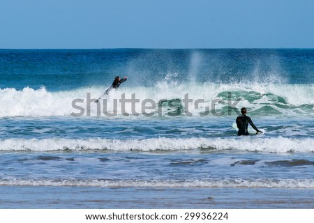 Two surfers in Newquay, Cornwall, England.