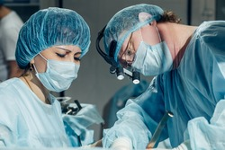 two surgeons at work in operating room. close up