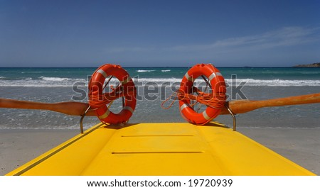 Two survival rings and a yellow lifeboat