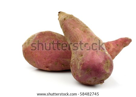 two sweet potatoes on a white background
