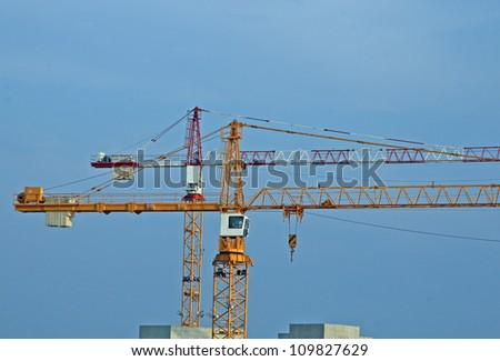 two tall steel crane at a construction site of construction