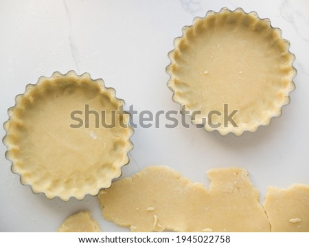 Two Tart shells filled with pastry Photo stock ©