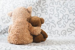Two teddy bear plush toy on a sofa. Concept of love and togetherness