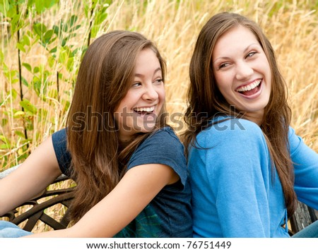 stock-photo-two-teen-girl-friends-laughing-76751449.jpg