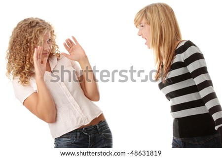 Two teen girls having an argue, isolated on white