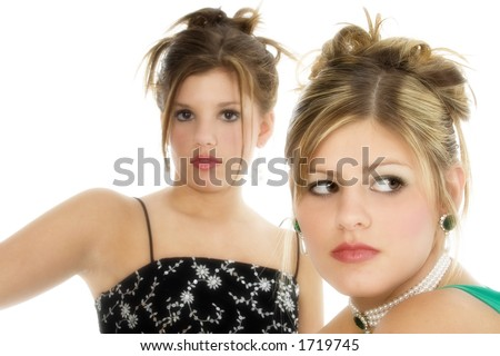stock photo : Two teen girls in formal dresses over white. Focus on teen in