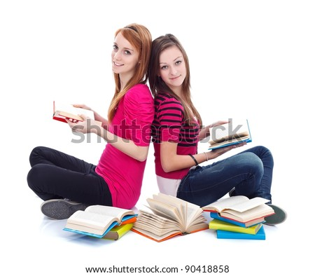 Two teen girls reading books