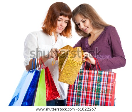 Two teen girls with bags look in the gold bag. Isolated on white background