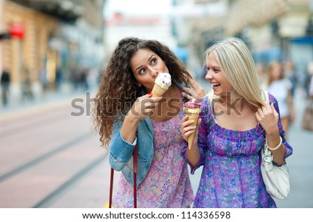 Two Teen Woman Friends Having Fun And Eating Ice Cream 114336598