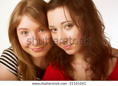 Two teenage girl friends together smiling