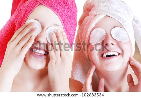 Two Teenage girls cares about skin near the eyes