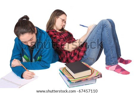 stock photo two teenage girls doing homework together on a white background 67457110 Talking Dirty  differences between men and women