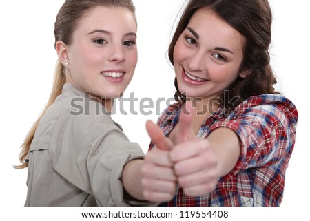 Two teenage girls giving the thumbs-up