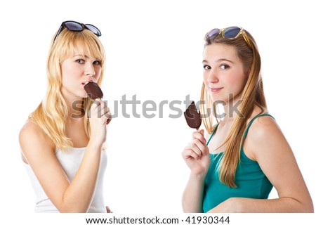 Two teenage girls is eating icecream. Isolated on the white background