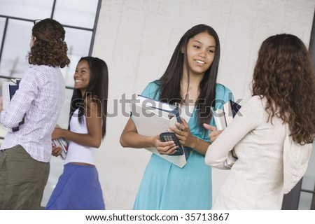 Two teenage girls talking to each other