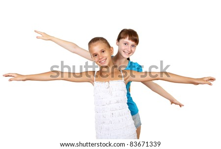 two teenage girls together in studio against white background